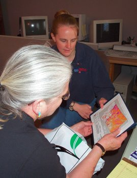 Kristie Smith reviews Montana Wind Map with NARFI's Director Timlynn Babitsky...