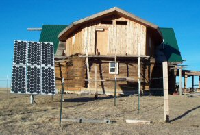 Solar panels complement the wind turbine (not shown) at the Demontiney log house off the grid at Rocky Boy's