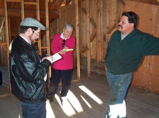 Tim Leeds and Timlynn Babitsky during our visit to Ted Demontiney's off-the-grid log home with its hybrid alternative energy system